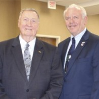 Caption: James K. Elrod and District 8 Commissioner Mike Middleton