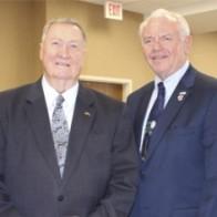 Caption: James K. Elrod and District 8 Commissioner Mike Middleton